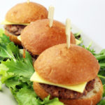 Mini beef burgers with cheese and pickles